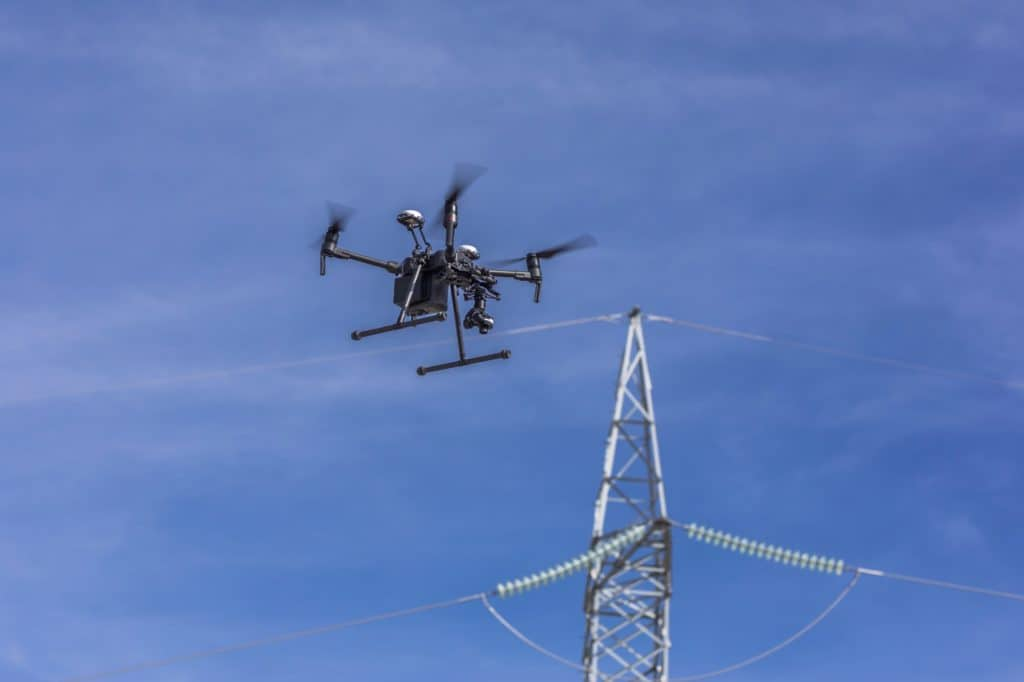 A word about drone inspection services - drone near transmission lines