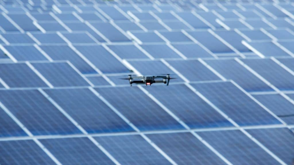 Drone flying over solar farm to collect inspection images